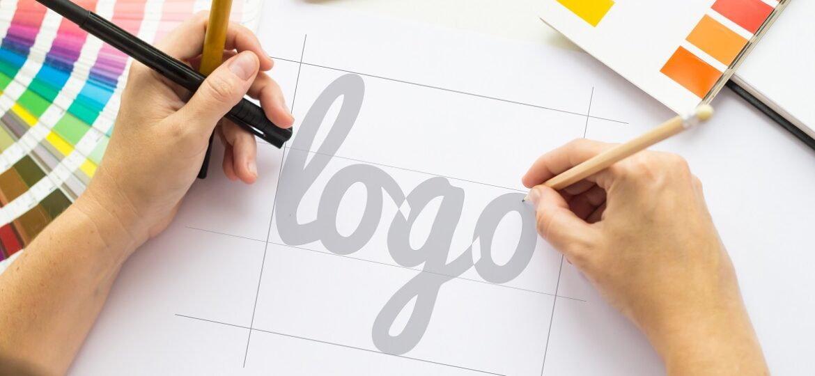 hands drawing a logo